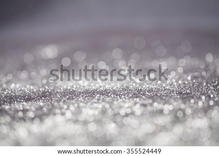 Silver Christmas and New Year bokeh, blinking background with copyspace - stock photo