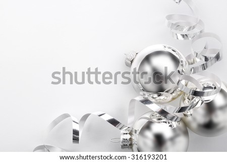 Silver Christmas balls and ribbon on white background - stock photo