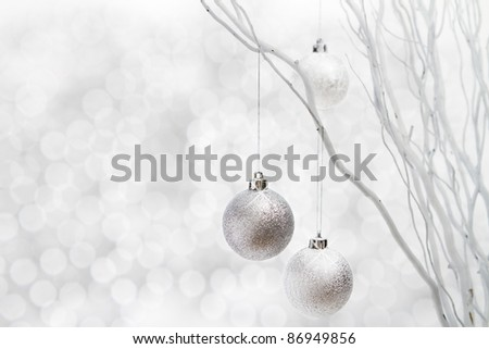Silver christmas balls hanging on white sticks floral arrangement - stock photo