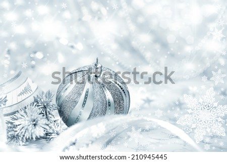 Silver Christmas bauble on abstract fective background, text space - stock photo