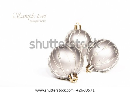 Silver christmas baubles on a white background with space for text - stock photo