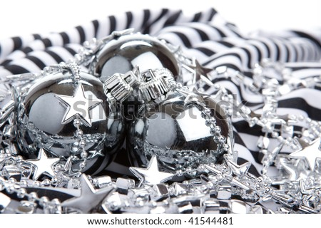 Silver Christmas baubles on striped background - stock photo