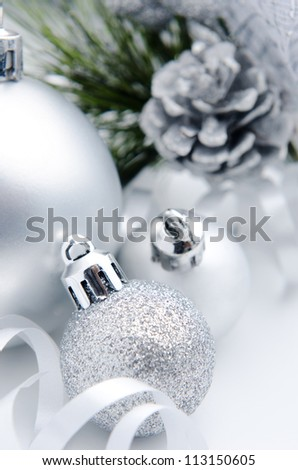 Silver christmas decoration festive ribbon bauble with acorn - stock photo