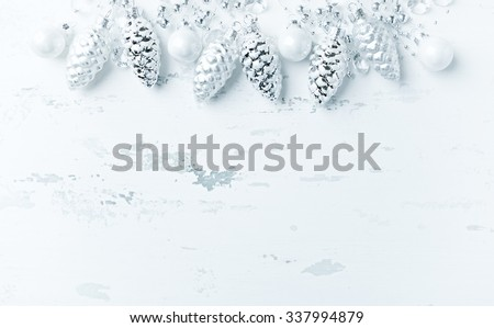 Silver Christmas decoration on a shabby chic background - stock photo