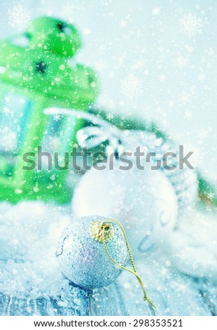 silver christmas decoration on the white snow - stock photo