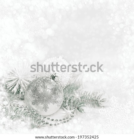 Silver Christmas decorations on abstract winter background, text space - stock photo