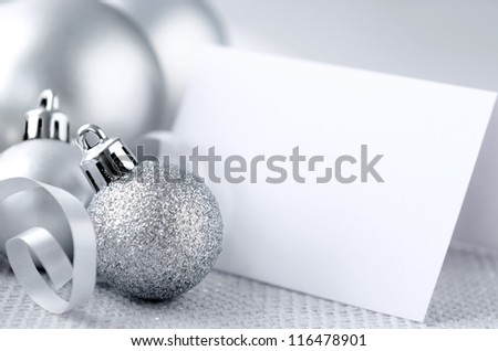 Silver christmas festive decoration bauble with copy space in empty name card - stock photo
