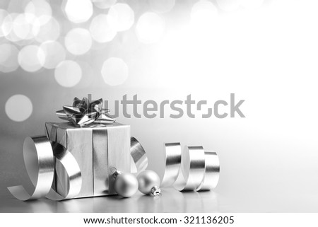 Silver Christmas gift box with ribbon - stock photo