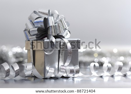 silver Christmas gift close up - stock photo
