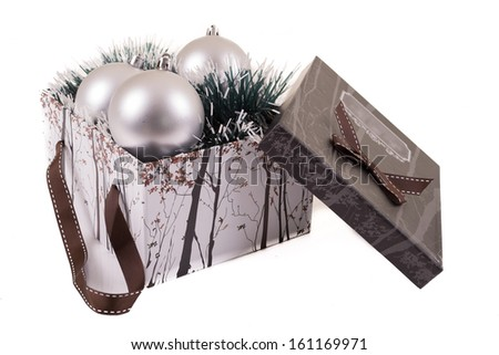 Silver Christmas gift  with ornaments - stock photo
