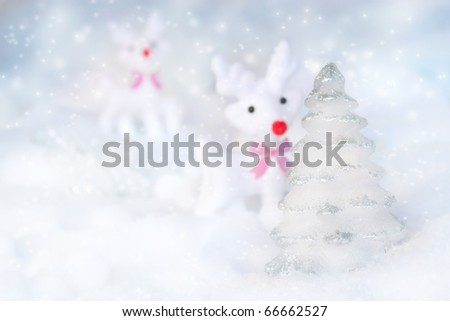 Silver Christmas tree with reindeer in the snow