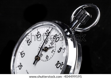 Silver chronometer object isolated on black background - stock photo