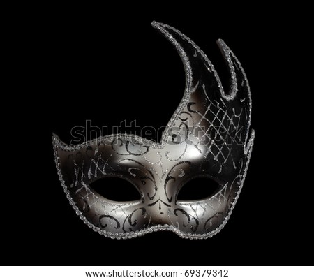 Silver classic carnaval venetian mask isolated on black - stock photo