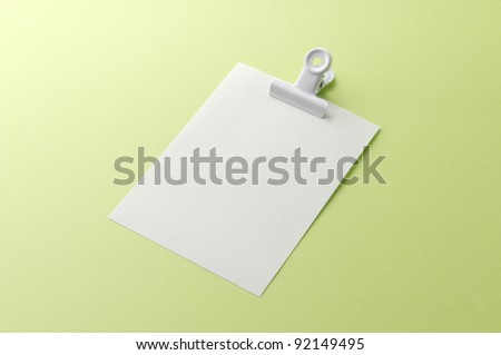 silver clip and blank note