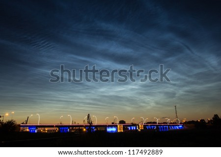Silver clouds. Noctilucent clouds are bright cloudlike atmospheric phenomena visible in a deep twilight. They are the highest clouds in the Earth's atmosphere. - stock photo
