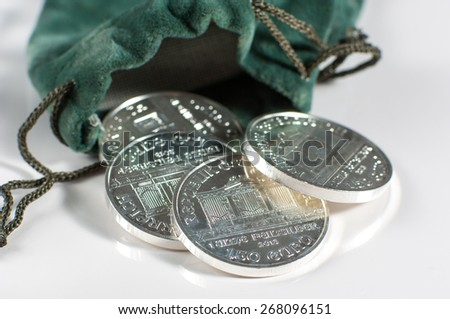 Silver coins. - stock photo