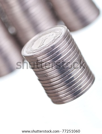 Silver coins stacks on white - stock photo