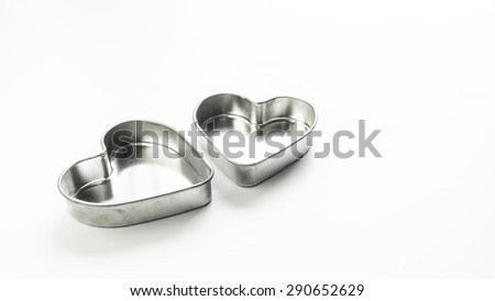 Silver color metal stainless steel heart love shaped pastry baking mould container. Isolated on white background. Concept of tools for lovely cake making. Copy space. - stock photo