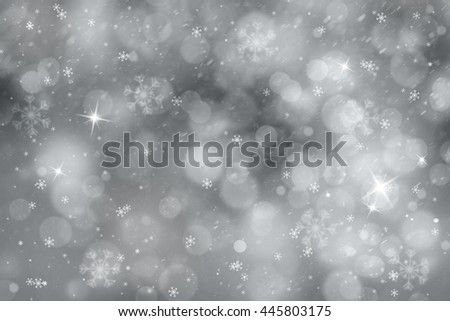 Silver colored abstract snowfall Christmas and New Year illustration background with sparkle.