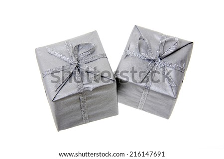 Silver-colored Christmas parcels, elevated view - stock photo