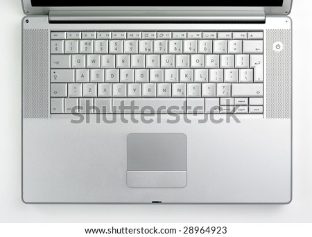 Silver coloured designer lap top key board taken from above - stock photo