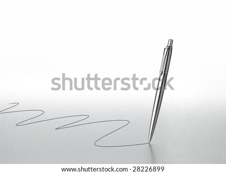 Silver coloured steel writing pen floating above a metal background as it writes with background space - stock photo