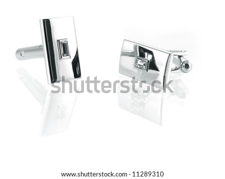 silver cuff link isolated on white background - stock photo