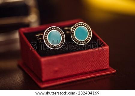 Silver cufflinks closeup in a box. - stock photo