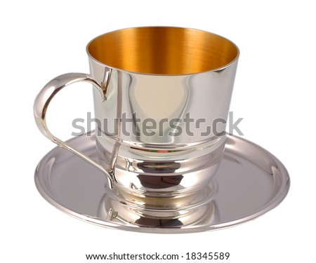 Silver cup on saucer - stock photo