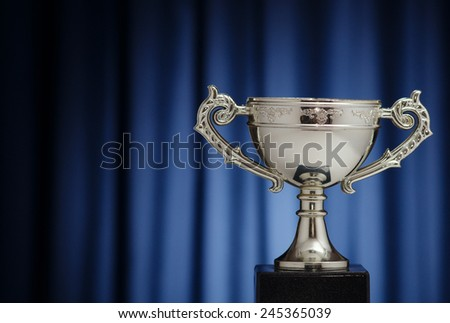 Silver Cup winner against the background of dark blue cloth - stock photo
