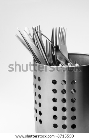 Silver cutlery in a luxury perforated stand. Detail. - stock photo