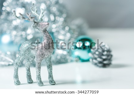 Silver Deer with silver star and Christmas tree and blue ball on background. Silver and blue Christmas ornaments.Xmas theme for your text and design. - stock photo