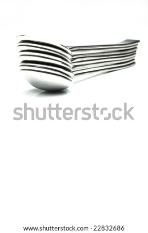 Silver desert spoons isolated against a white background