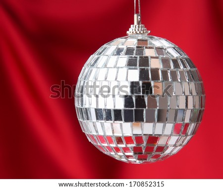 silver disco ball , isolated on red background - stock photo