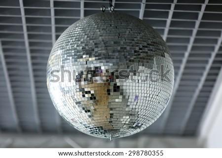 Silver disco mirror ball close up - stock photo