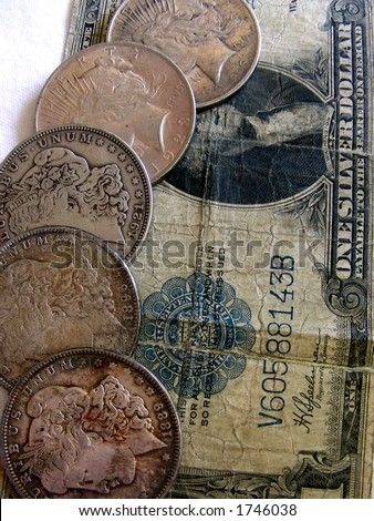 Silver Dollars, 5 in coin, 1 paper - US currency - stock photo