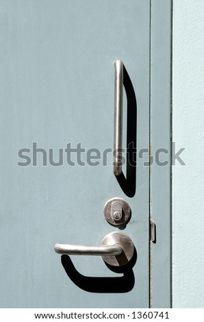 Silver Doorhandle on turquoise door