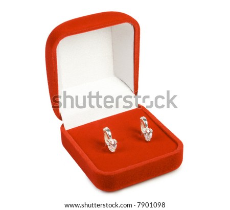 Silver earring in red box. Isolate on white. - stock photo