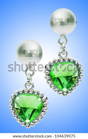 Silver earrings isolated on the white background - stock photo