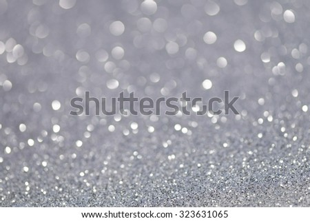 Silver elegant glittering Christmas lights. Blurred abstract background