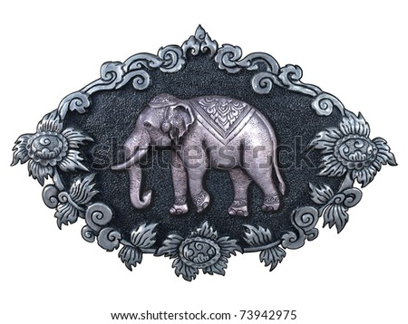 Silver elephant and silver frame handmade in a Thai temple. - stock photo