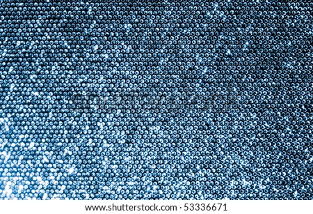Silver fabric made of a grid of sparkling sequins. - stock photo