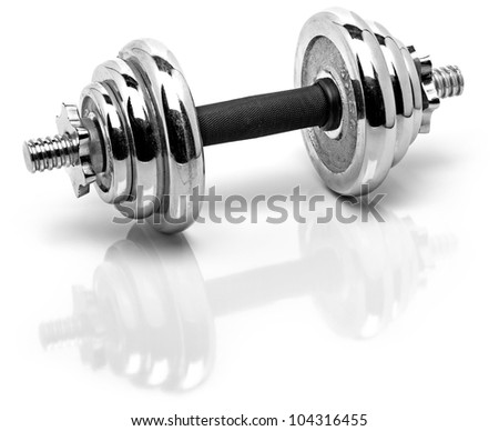 silver fitness weights with reflection on a white shiny surface - stock photo