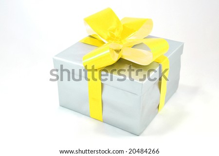 Silver gift box with yellow bow isolated on white