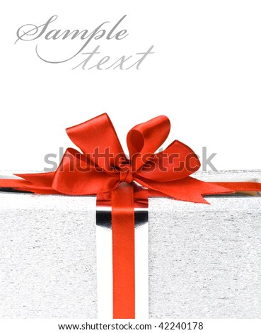Silver gift boxes with red ribbons - stock photo