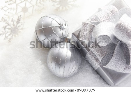 Silver gift in snow - stock photo