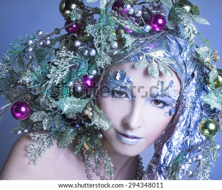 Silver girl. Young woman in creative New Year image. - stock photo