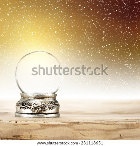 silver glass ball and golden space  - stock photo