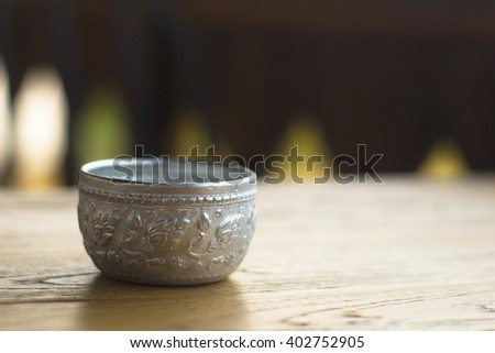 Silver glass on wood desk