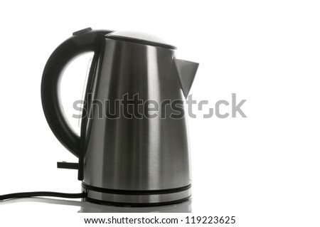 Silver grey electric kettle with cord isolated on white - stock photo